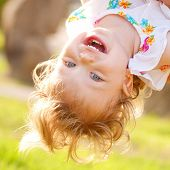 image of upside  - Happy baby playing and laughing upside down - JPG