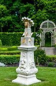 stock photo of sundial  - Old sundial with a gazebo in the background in a mansion garden - JPG