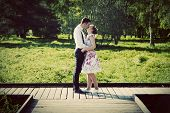 stock photo of cross-dress  - Young couple in love standing on wooden cross - JPG