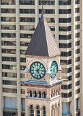 picture of city hall  - Old City Hall Clock Tower against a modern building background the Old City Hall is a heritage building and a major tourist attraction - JPG