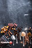 picture of chocolate spoon  - Sweet spices in the spoons and chocolate on a table black - JPG