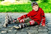 pic of 7-year-old  - Cool 7 year old boy rollerskates on the street - JPG