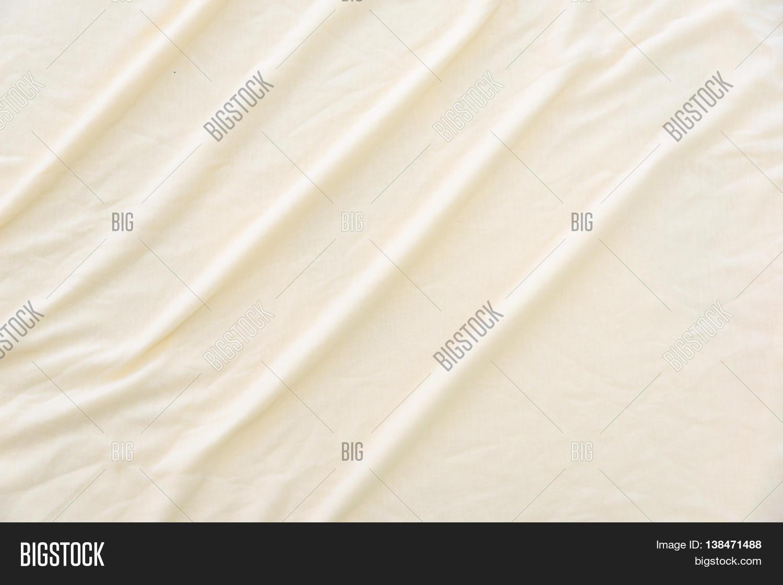 Wrinkled bed sheets texture - Close Up Of Wrinkled Beige Color Bed Sheet Texture Background