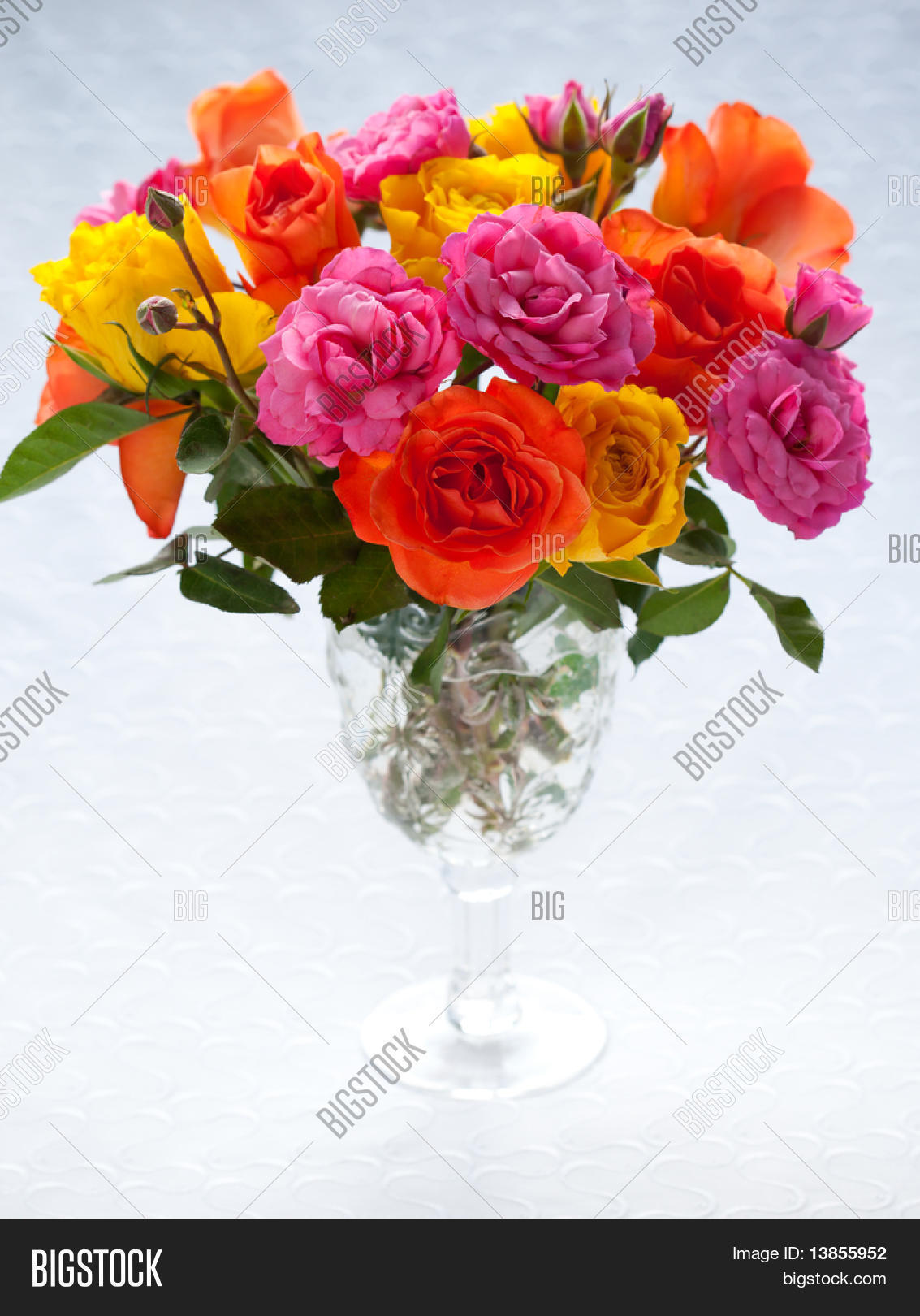 bouquet of multi-colored roses in vase Stock Photo & Stock ...