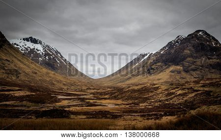 Snow capped mountains in Glencoe Scotland UK
