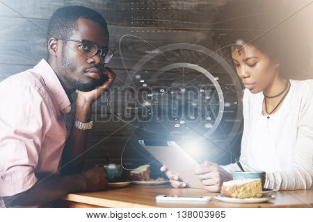 Double Exposure Of Young African Couple Sitting At A Cafe, Man Looking Sad, Bored, Frustrated And Of