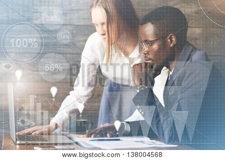 Visual Effects. Team Work. African Man Sitting In Front Of Laptop, Resting His Elbow On The Table, L