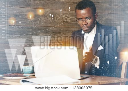 Visual Effects. African Office Worker In Elegant Suit Annoyed With His Computer Hung, Looking At The
