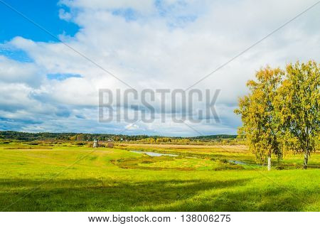 Autumn sunny rural landscape of Soroti river valley in Pushkinskiye Gory, Russia - autumn natural landscape of autumn nature in sunny autumn weather. Soft focus processing