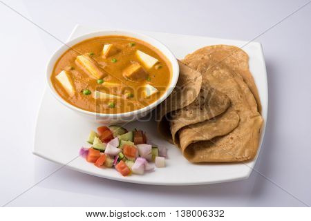 Paneer Tikka Masala, Curry, Indian food, India,Folded homemade wheat chapati (Indian bread) served with delicious Indian paneer butter masala