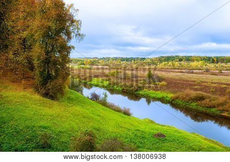 Autumn cloudy birds eye view landscape of Soroti river and autumn forest trees Russia - autumn natural landscape of autumn forest yellowed nature in autumn cloudy weather. Soft filter processing