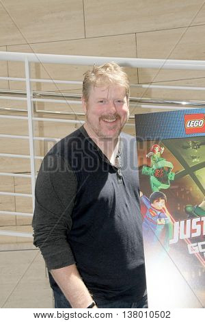 John DiMaggio arrives at the premiere of