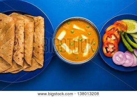 paneer butter masala with chapati / roti / paratha / fulka / indian bread and green salad
