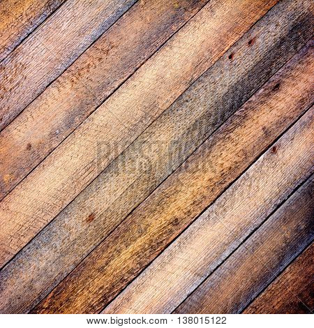 background texture old gray barn board with diagonal wooden slats. toned square photo