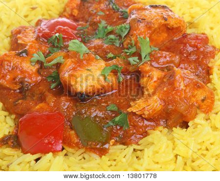 Indian chicken jalfrezi curry with pilau rice