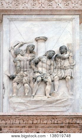 BOLOGNA, ITALY - JUNE 04: The Flagellation of Christ by Giacomo Scilla, right door of San Petronio Basilica in Bologna, Italy, on June 04, 2015