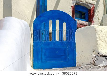Houses in traditional blue-white colors in the village Oia on Santorini Island. Greece.