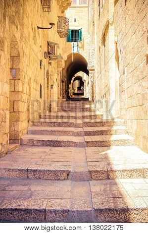 Israel, Jerusalem, stone streets Jerusalem ancient architecture. The tunnel with steps.