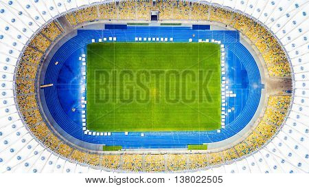 Aerial view of the Olympic Stadium in Kiev. Ukraine. The field for the football game. The largest stadium of city from helicopter. Outdoor.