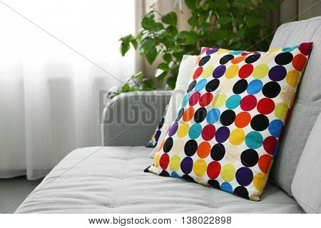 Pillows on sofa in room
