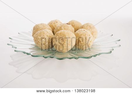 Indian favourite sweet coconut laddu or laddoo or nariyal ladu