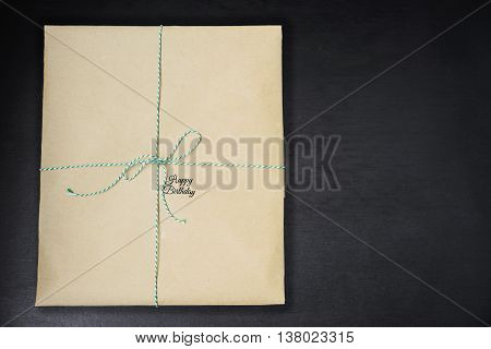Happy birthday inscription on wrapped in kraft paper gifts
