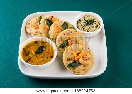 south indian favourite food rava idli or semolina idly or rava idly, served with sambar and green chutney, isolated
