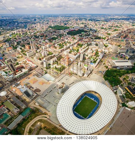 Aerial view of the Olympic Stadium and Kiev city. Ukraine. The field for the football game. The largest stadium of city from helicopter. Outdoor.