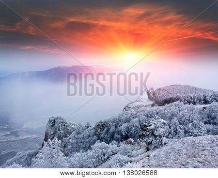 Mountain sunset scene in winter time