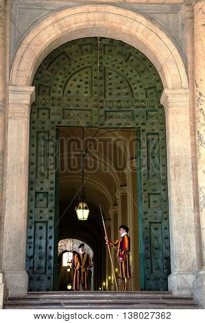 ROME, ITALY - MAY 12, 2012: Papal Swiss guard standing at the Vatican Museum door