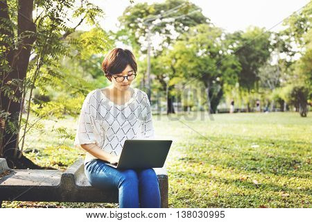 Woman Using Tablet Environmental Park Relaxation Concept