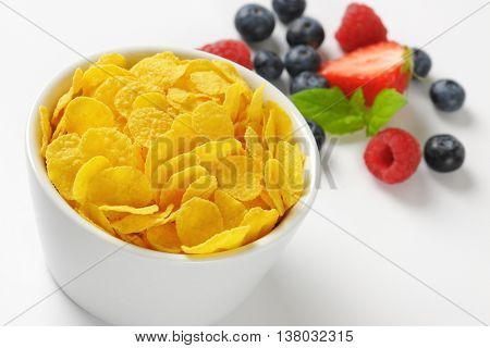 bowl of corn flakes and berry fruits - close up
