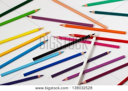 Set of colorful crayons on white background, and black and white pencils from top, back to school.
