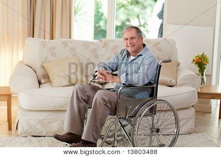 Senior man in his wheelchair at home