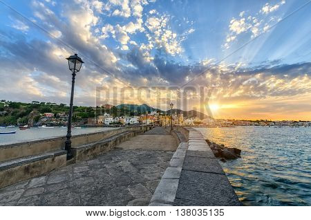 Evening cityscape of Ischia at sunset town in the Metropolitan City of Naples Italy