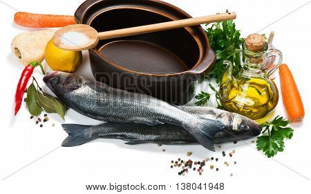 Open empty casserole fresh fish raw vegetable and spices for soup isolated on white background.