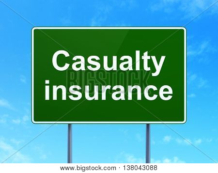 Insurance concept: Casualty Insurance on green road highway sign, clear blue sky background, 3D rendering