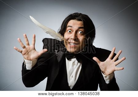 Funny writer with quill in vintage concept