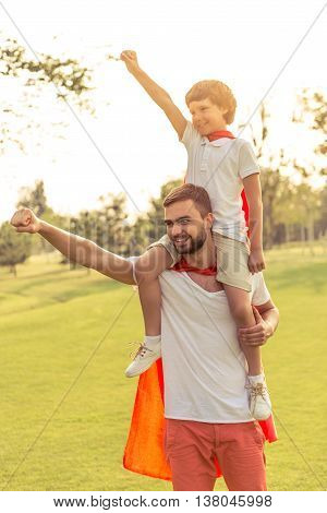 Dad And Son Playing Superheroes