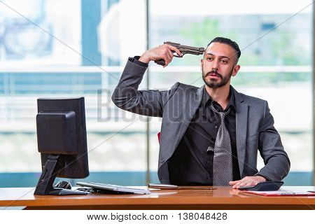 Desperate broke man committing suicide in the office