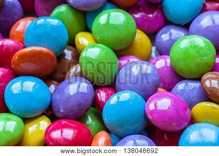 Close up view of colorful chocolate beans as texture background.