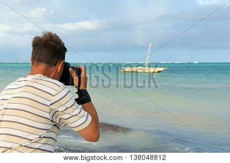 Photographer photographed old fishing boat in the ocean