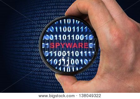 Computer security concept. Spyware alert inside magnifying glass in binary code.
