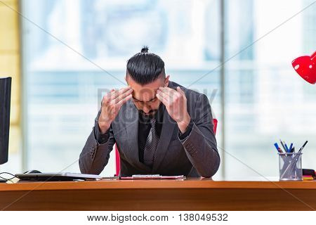 Sad businessman sitting in the office
