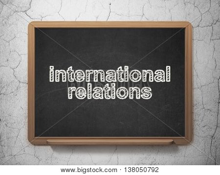 Politics concept: text International Relations on Black chalkboard on grunge wall background, 3D rendering