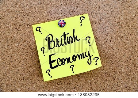 Yellow Paper Note Pinned With Great Britain Flag Thumbtack, Text British Economy And Question Marks