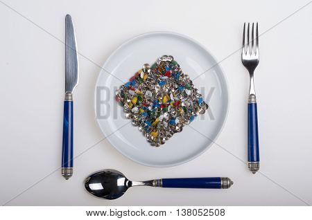 plate full of colorful sharp thumbtacks, as was the dish of a meal