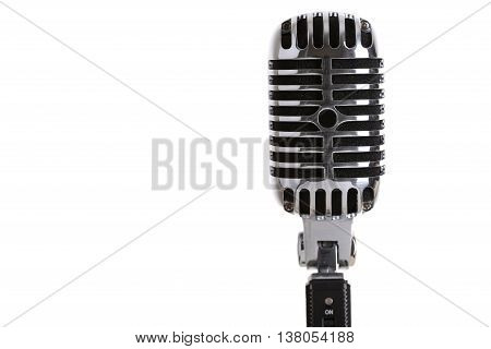 MINSK BELARUS - AUGUST 1 2015: Silver old fashioned stage microphone like shure (Elvis microphone). Karaoke vocal learning music shop or radio concept. Retro style mic ready to rock