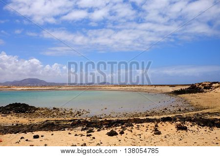 View on a sand beach and a lagoon with transparent water on the Canary island Lobos Spain.