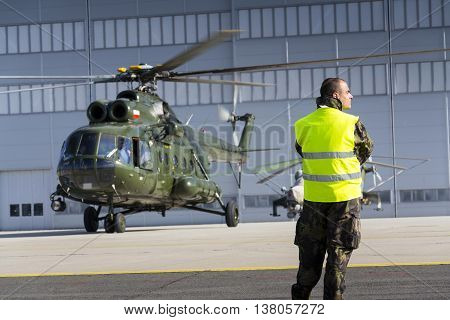 Ostrava, Czech Republic - September 22: Man In Military Uniform Stands In Front Of Polish Mi-8T Heli